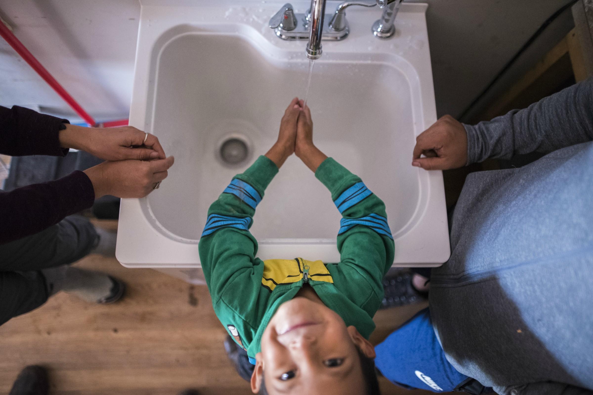 Child washing hands in sink_1 (1)